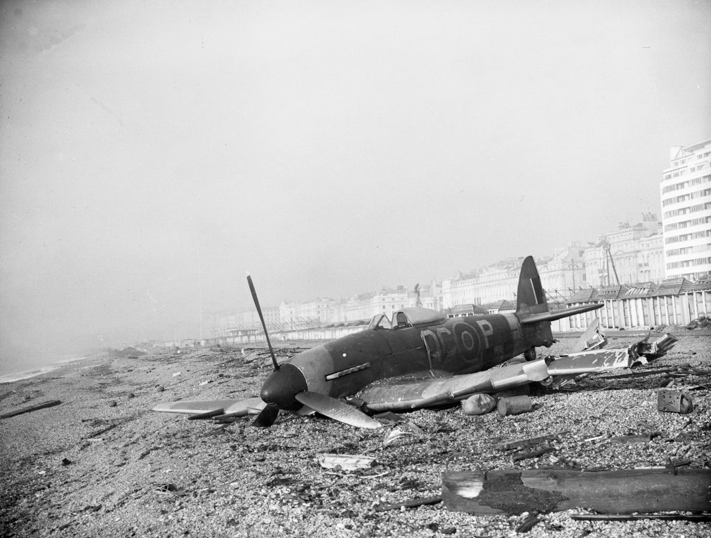 Damaged aircraft on Brighton Beach, 1940s